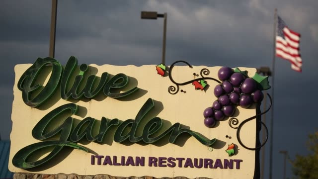 signage is displayed outside an olive garden restaurant in louisville kentucky us on wednesday sept 28 - Olive Garden Louisville