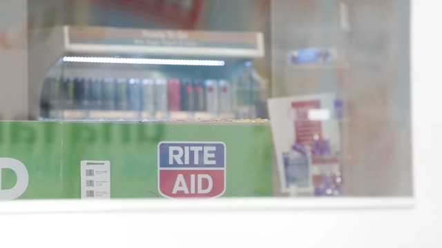 stockvideo's en b-roll-footage met signage is displayed outside of a rite aid corp store in downtown los angeles california us on wednesday september 21 shots view of rite aid pharmacy... - griepvaccin
