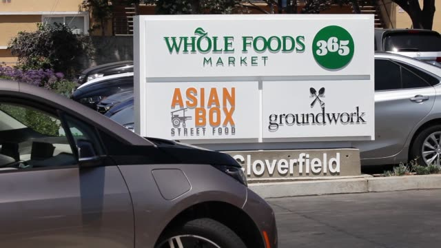 signage is displayed outside of a whole foods market 365 location during the grand opening in santa monica california us on wednesday aug 9 2017... - whole foods market stock videos and b-roll footage