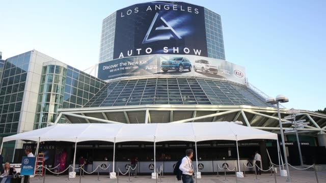 signage is displayed outside of the la convention center ahead of the los angeles auto show in los angeles california us on monday nov 14 2016 - motor show stock videos and b-roll footage