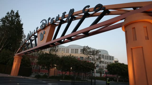 signage is displayed outside of the entrance to the walt disney studios in burbank, california, us, on monday, may 9, 2016 shots several similar wide... - アニメーター点の映像素材/bロール
