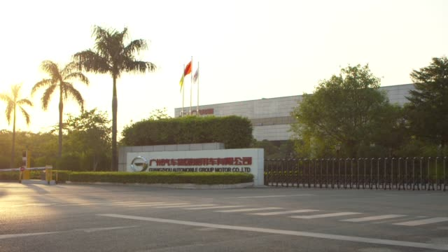 Signage is displayed outside the Guangzhou Automobile Group Co Ltd plant in Guangzhou China on Thursday Nov 2 Flags fly outside the Guangzhou...