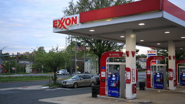 signage is seen at an exxon mobil corp gas station in falls church virginia us on tuesday april 28 2020 exxon is scheduled to release earnings... - falls church video stock e b–roll