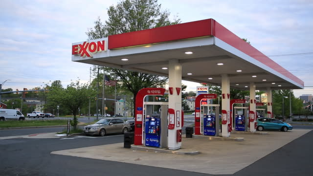 signage is seen at an exxon mobil corp. gas station in falls church, virginia, u.s., on tuesday, april 28, 2020. exxon is scheduled to release... - falls church stock videos & royalty-free footage