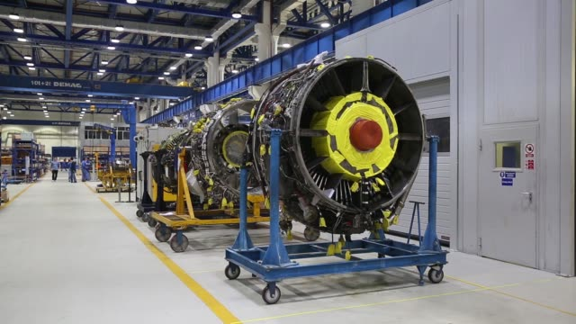 signage of mtu maintenance zhuhai co a joint venture between mtu aero engines co and china southern holding co is displayed atop the company's plant... - general electric stock videos and b-roll footage