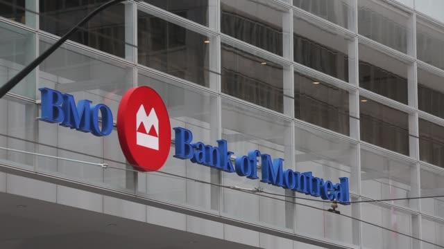 signage of the bank of montreal in toronto's bay street/financial district in toronto ontario canada on may 19 2017 shots wide shot of bmo and... - financial building stock videos and b-roll footage