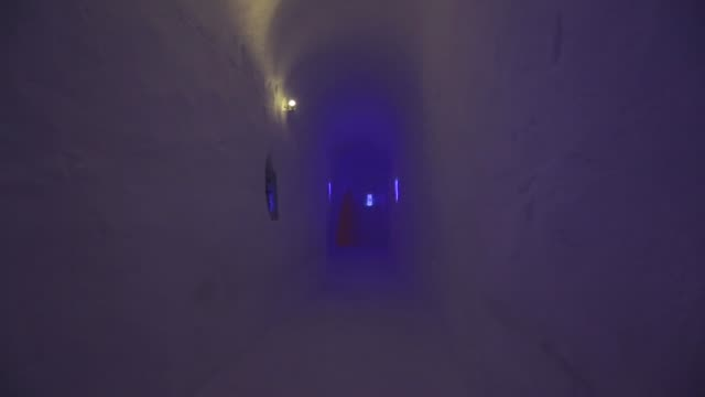 stockvideo's en b-roll-footage met signage of the igloo hotel operated by iglu dorf gmbh on the parsenn mountain in this arranged photograph taken above the town of davos switzerland... - goede staat