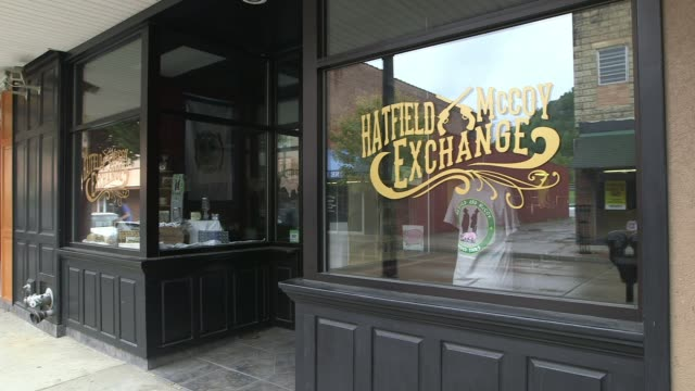 signage on store window of hatfield and mccoy exchange - hatfield stock videos and b-roll footage