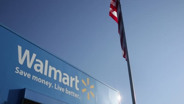 Signage stands in front of the Walmart Stores Inc Home Office headquarters building in Bentonville Arkansas US on Wednesday July 29 2015 Shots...
