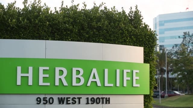 Signage stands outside of the Herbalife Ltd Plaza in Torrance California US on Wednesday May 4 2016 Shots shot of Herbalife signage on side of...
