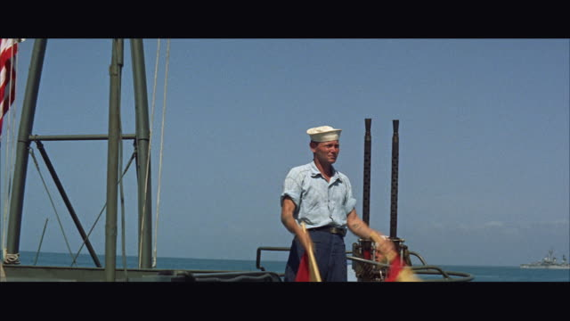 ms signalman waving flags on ship - marinaio video stock e b–roll