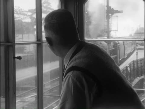 ms signals changing and man looking train from out of window, freight train passing through station / lickey, worcestershire, england - worcestershire stock videos and b-roll footage