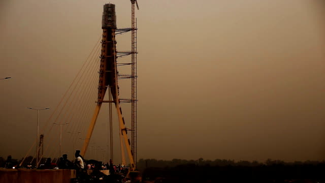signature bridge (cable-stayed bridge) on yamuna river, delhi - cantilever bridge stock videos & royalty-free footage