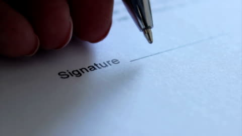 signature with left hand - document stock videos & royalty-free footage