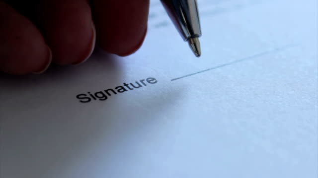 signature with left hand - signature stock videos and b-roll footage