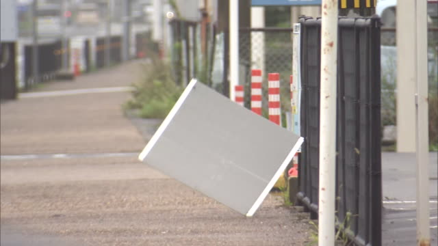 signboard about to be blown by strong wind, wakayama, japan - roadside stock videos & royalty-free footage