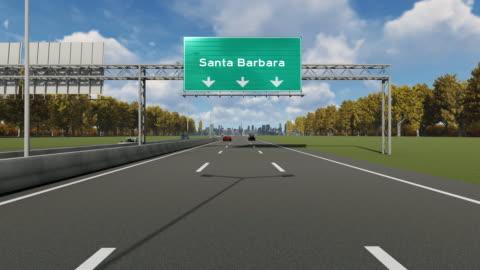 signboard on the highway indicating the entrance to usa santa barbara city - santa barbara california stock videos & royalty-free footage