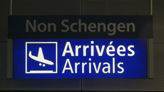 cu signboards at airport / airport luxembourg-findel, luxembourg - 発着案内板点の映像素材/bロール