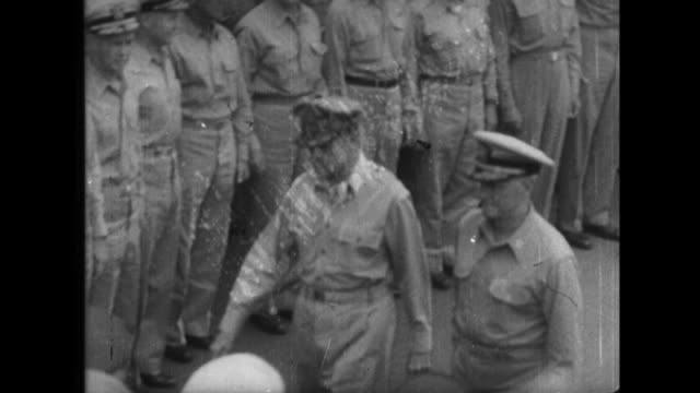 signers of the japanese instrument of surrender at the end of world war ii on the uss missouri include general douglas macarthur foreign minister... - arrendersi video stock e b–roll