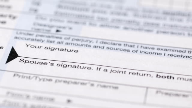 signing a tax form - tax form stock videos & royalty-free footage