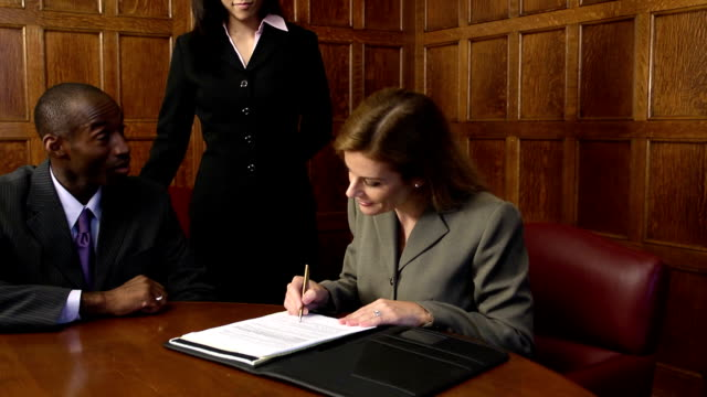 Signing an Agreement - Female Executive