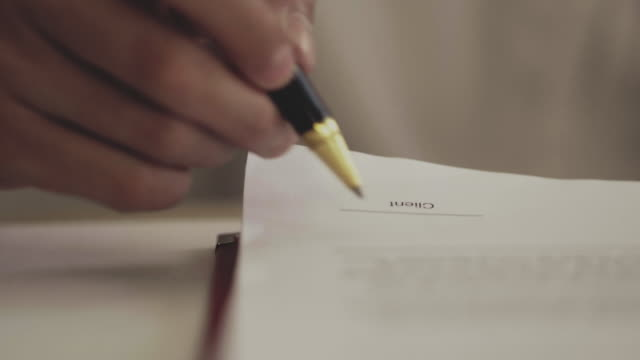 signing contracts - agreement stock videos & royalty-free footage