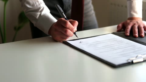 signing official document - document stock videos & royalty-free footage