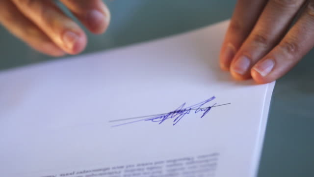 signing_documents bs of - sign stock videos & royalty-free footage