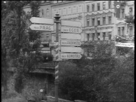 b/w 1938 signpost with signs pointing toprag eger near foilage / sudetenland annexed - traditionally czech stock videos and b-roll footage