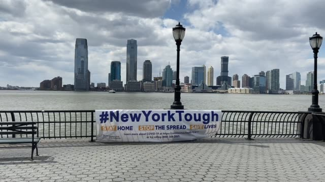 signs along the battery park promenade major cities in the us adjust to restrictive coronavirus measures on april 16 2020 in battery park new york... - message stock videos & royalty-free footage