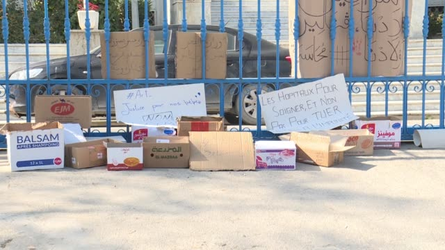 signs and twelve empty cardboard boxes representing the dozen newborn babies whose deaths at a tunisian state hospital sparked public outrage are... - tunis stock videos & royalty-free footage