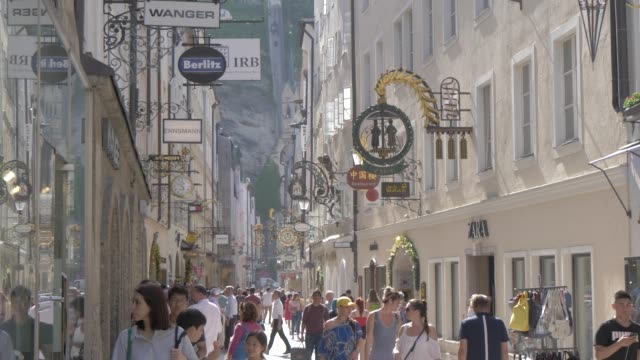 signs and visitors on getreidegasse, unesco world heritage site, salzburg, austria, europe - ice cream cone stock videos & royalty-free footage