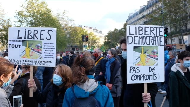 signs are held as people gather in place de la république to pay tribute to professor samuel paty and to defend freedom of expression on october 18... - decapitated stock videos & royalty-free footage