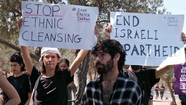 """signs are held up saying """"stop ethnic cleansing"""" and """"end israeli apartheid"""" as israeli left-wing activists and palestinians take part in a... - campaigner stock videos & royalty-free footage"""