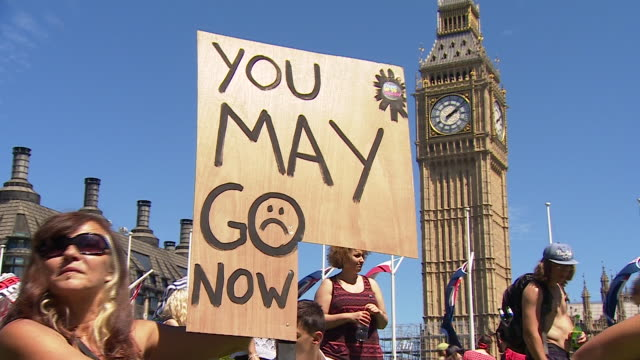 signs at a protest in westminster calling for theresa may to step down as prime minister after the result of the general election - allgemeine wahlen stock-videos und b-roll-filmmaterial