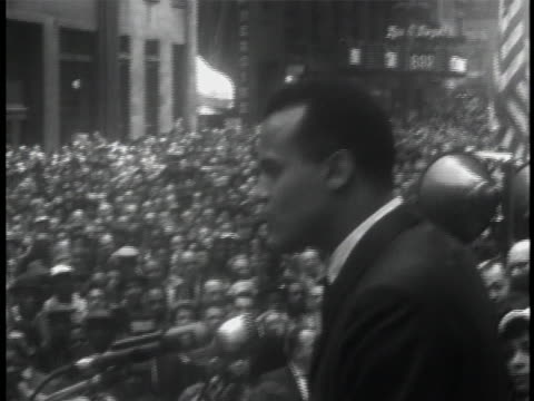 signs at rally pan right crowd of listeners high angle shot crowd high angle shot women dressed in fancy hats clapping wide shots people clapping... - harry belafonte stock videos & royalty-free footage