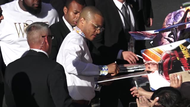 TI signs for fans outside the AntMan and the Wasp premiere in Hollywood in Celebrity Sightings in Los Angeles