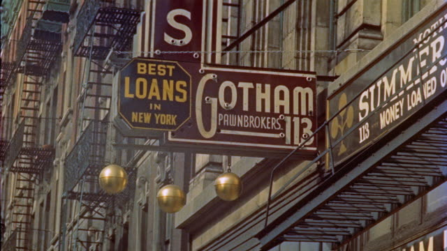 1953 la montage signs for pawnbroker and storage businesses on building facade / new york city - pawnbroker stock videos & royalty-free footage