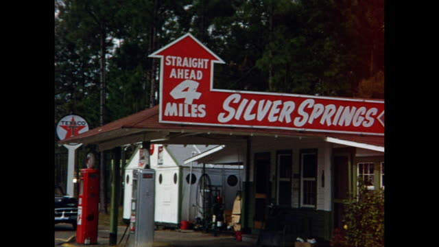 vidéos et rushes de 1954 montage pov signs for silver springs and gas station, silver springs, florida, usa - 1954