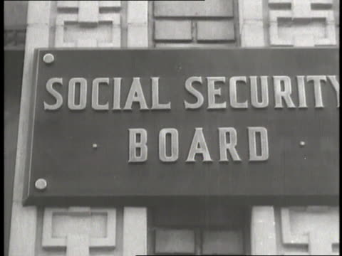 a signs hangs on the exterior of the social security board building - social security stock videos & royalty-free footage