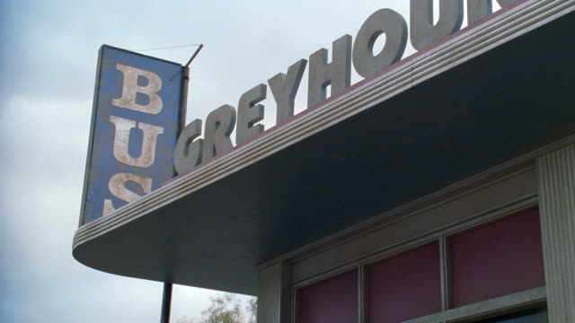 signs identify a building as a greyhound bus depot. - 1998 stock videos & royalty-free footage