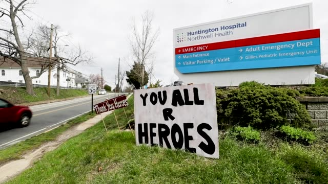 signs in front of huntington hospital salute the medical workers on april 10, 2020 in huntington, new york. according to johns hopkins university,... - ロングアイランド点の映像素材/bロール