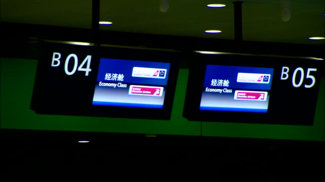 signs indicate travel costs in economy class at the shanghai pudong international airport. - economy class stock videos & royalty-free footage
