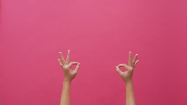 signs language hand isolated pink background 4k - pink background stock videos and b-roll footage
