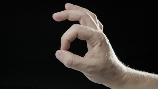 Signs language hand slow motion black background caucasian human