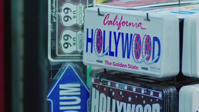 cu tu signs of hollywood hanging on rack at night / hollywood, city of los angeles, california, united states - group of objects stock videos & royalty-free footage