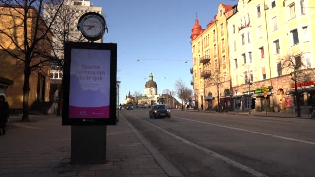 signs on digital advertising boards by roads in stockholm from the city's regional council warn residents to wash their hands regularly and to stay... - stockholm stock videos & royalty-free footage