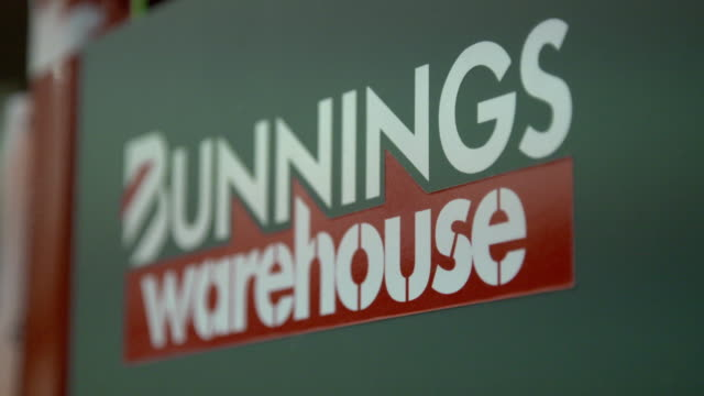 Signs on display for tool shop and store branding at Bunnings Warehouse hardware store