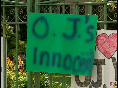 signs outside of oj simpsons estate from people showing support and saying he is innocent - orange juice stock videos & royalty-free footage