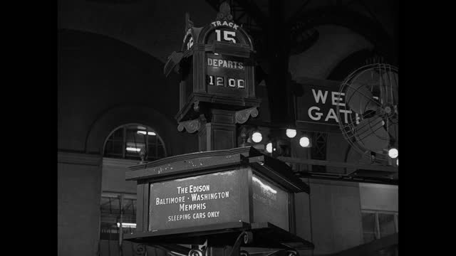 """signs point out """"the edison,"""" """"baltimore washington memphis,"""" and """"sleeping cars only"""" near the tracks at new york city's penn station. - new york city penn station stock videos & royalty-free footage"""